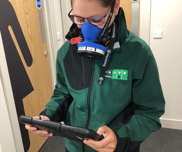 Ensafe employee undertaking asbestos air monitoring