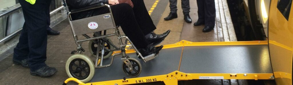 Portaramp product assisting Wheelchair user onto a train
